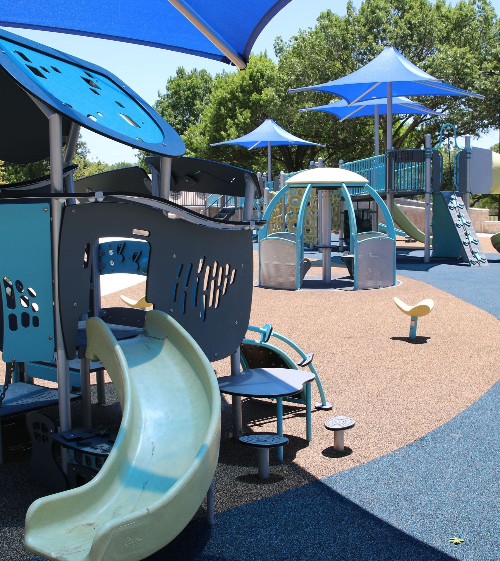 Central Park Playground with slide and other platforms with spinner seat in the middle
